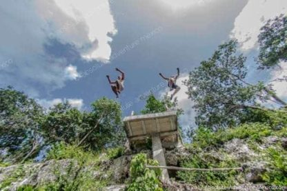 jumpr from cliff in cenote