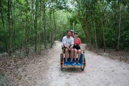 Tricycle through jungle at Coba